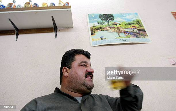 A man drinks beer in AlKahaf or The Cave Bar January 27 2004 in Baghdad Iraq The bar serves beer and liquor and caters to men only Saddam Hussein...