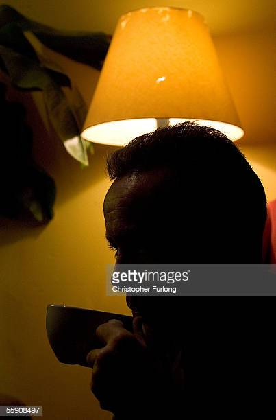 Man drinks coffee in a cafe as darkness falls on October 11, 2005 Glasgow, Scotland. Seasonal affective disorder , or winter depression, is a mood...