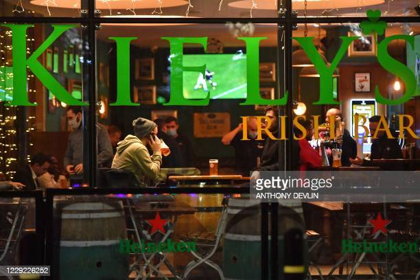 A man drinks in an Irish bar in Manchester city centre northwest England on October 22 2020 ahead of new coronavirus restrictions coming into force...