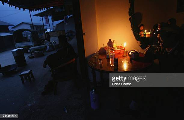 A man drinks tea in a restaurant at a village that borders China on March 16 2006 in Panwa Kachin State Special Region 1 of Kachin State Myanmar The...