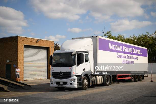 Man drives a Class 1 HGV as he takes part in a driving lesson at the NDC heavy goods vehicle training centre on September 22, 2021 in Croydon,...
