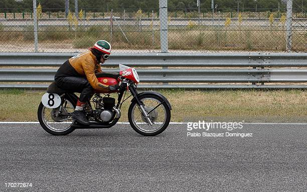 A man drives a classic motorbike at the Jarama Circuit on June 9 2013 in Madrid Spain The Jarama Vintage Festival seeks to revive the 1960s 70s and...
