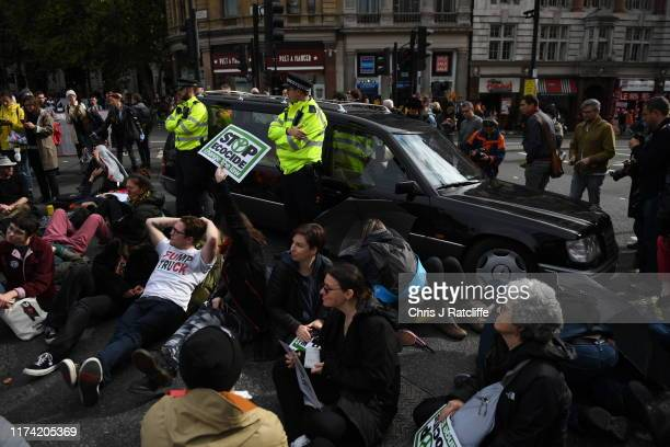 A man drives a hearse as Extinction Rebellion protesters gather in Trafalgar Square on October 7 2019 in London England Climate change activists are...