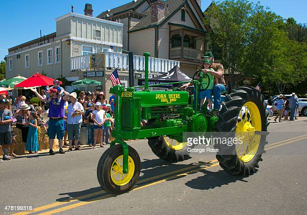 A man drives a historical John Deere tractor in the 53rd Annual Santa Ynez Day Parade on June 13 in Santa Ynez California Because of its close...