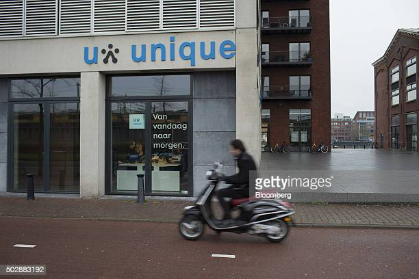 A man drives a moped past the Unique job center flagship store operated by USG People NV in Amsterdam Netherlands on Tuesday Dec 29 2015 Recruit...