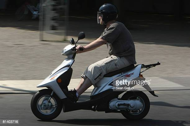 A man drives a moped through the city center on June 4 2008 in Berlin Germany Moped and scooter sales have been rising progressively in the last six...