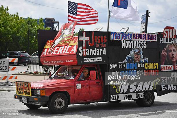 A man drives a pickup covered in billboards through downtown in the first day of the Republican National Convention on July 18 2016 in Cleveland Ohio...