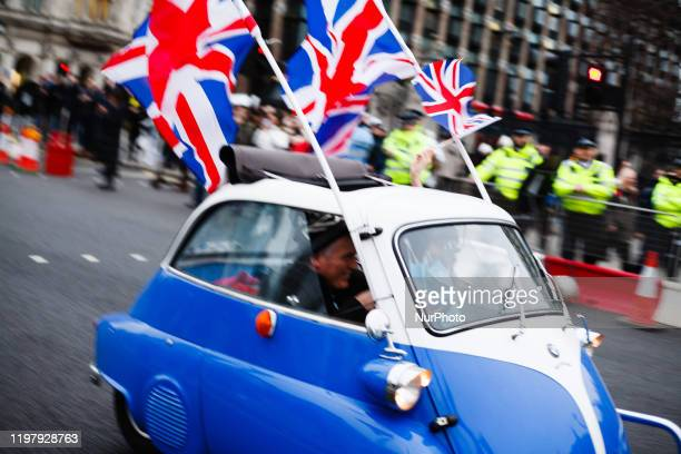 Man drives a tiny car fitted with Union Jack flags through Parliament Square in London, England, on January 31, 2020. Britain's exit from the...