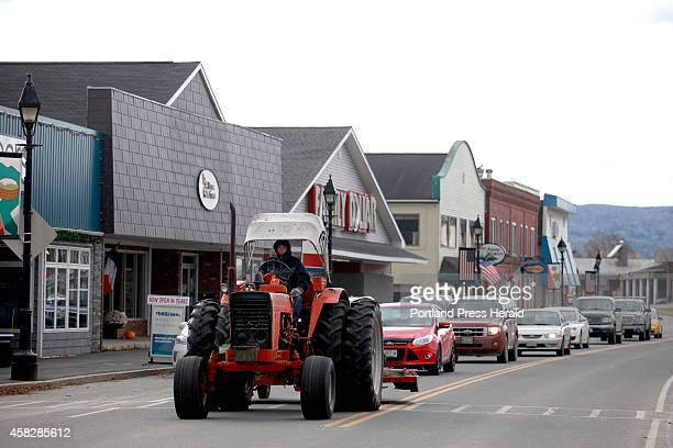 A man drives a tractor down Main Street in Fort Kent creating a traffic jam of sorts Saturday morning November 1 2014 The Fort Kent community reacts...
