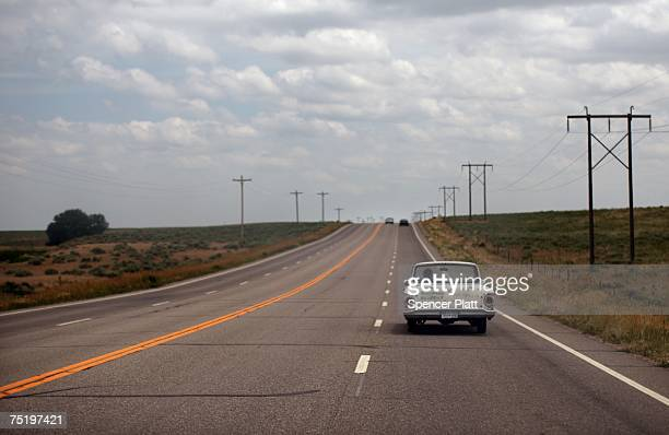 A man drives a vintage automobile down a highway June 27 2007 in WrayColorado When rural America was chronicled 50 years ago by Jack Kerouac in his...
