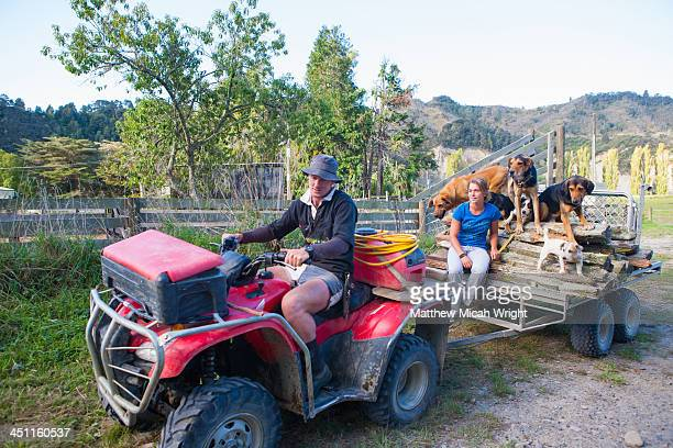 A man drives across the countryside in an ATV.