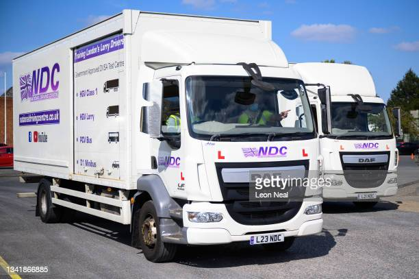 Man drives an HGV lorry as he takes part in a driving lesson at the NDC heavy goods vehicle training centre on September 22, 2021 in Croydon,...