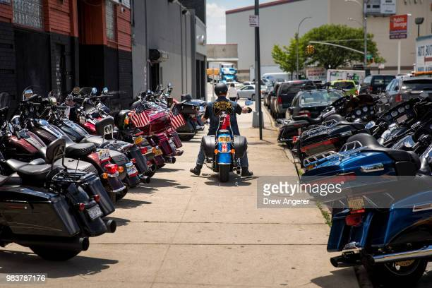 A man drives away on his HarleyDavidson motorcycle after picking it up from the service garage of the HarleyDavidson of New York City showroom store...