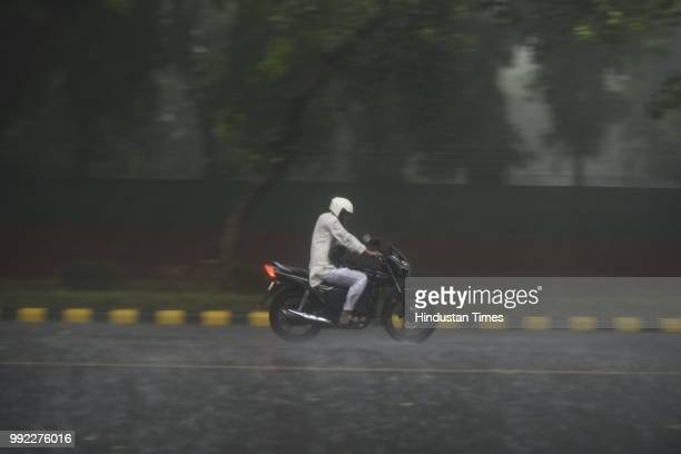 A man drives during heavy monsoon rains at KG Marg on July 5 2018 in New Delhi India