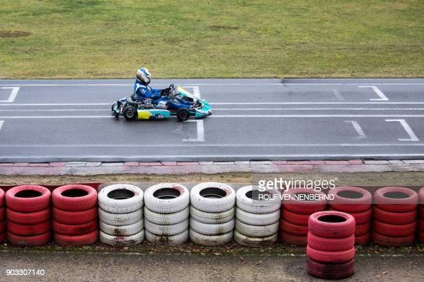 A man drives his go kart on January 10 2018 at the karting circuit in Kerpen located 30 kilometres from Cologne in western Germany The gokarting...