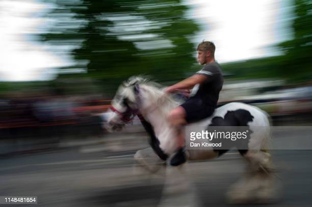 Man drives his horse down the 'mad mile' during the annual Appleby Horse Fair on June 07, 2019 in Appleby-in-Westmorland, England. The annual...