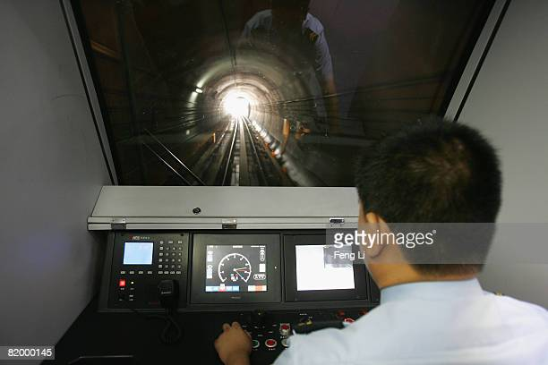 Man drives the new Airport Express train on July 19, 2008 in Beijing, China. After seven years of construction, three new subway lines will be put in...