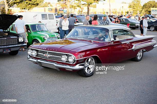 man driving a 1960 chevrolet impala - chevrolet impala stock pictures, royalty-free photos & images