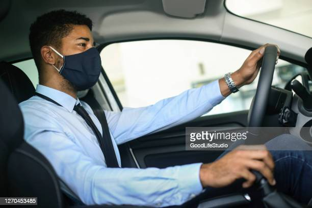 man driving a car during the pandemic - domestic car stock pictures, royalty-free photos & images