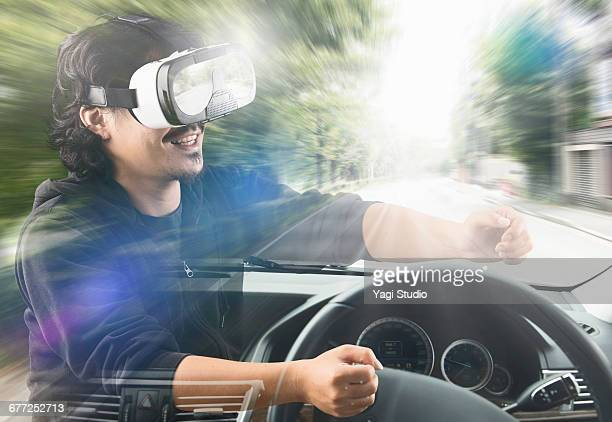Man driving a car in a virtual reality