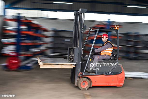 Man driving a forklift in blurred motion.