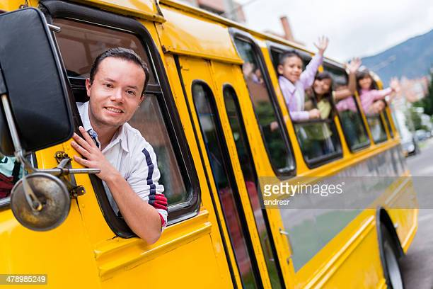 Man driving a school bus
