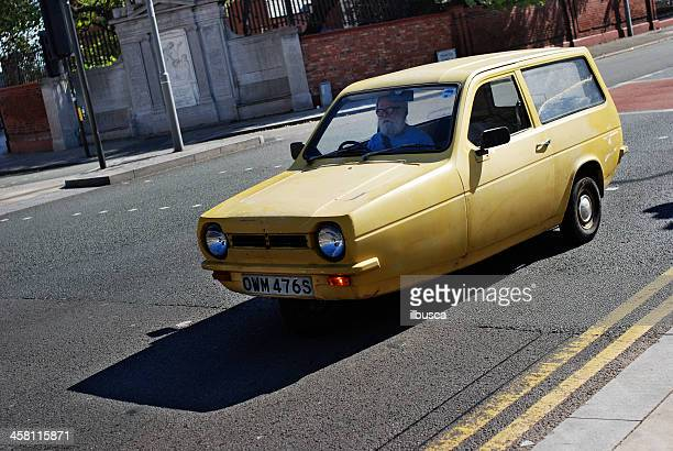 Man driving a yellow Reliant Robin