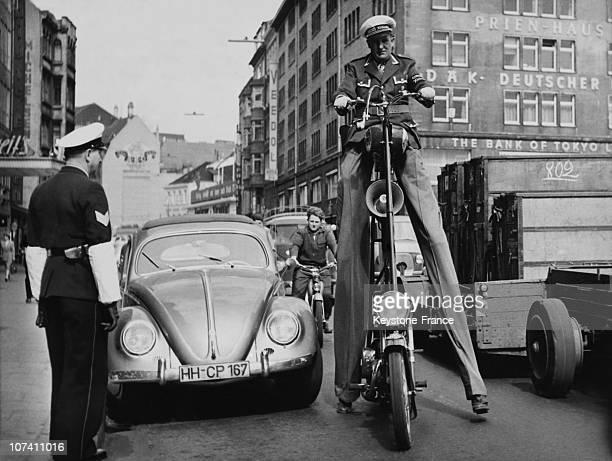Man Driving An Unusual Motorcycle At Hamburg In Germany On April 1957