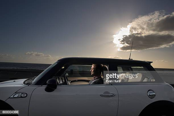 Man driving by the sea