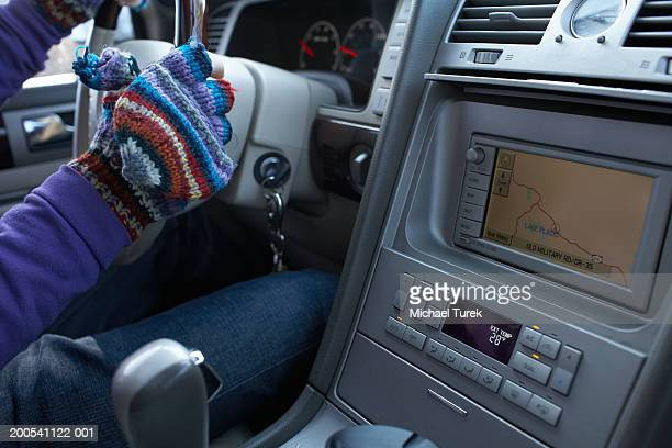 Man driving car, close-up of navigation system