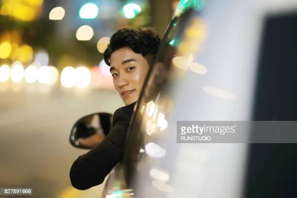 man driving car, looking back over shoulder - looking over shoulder ストックフォトと画像