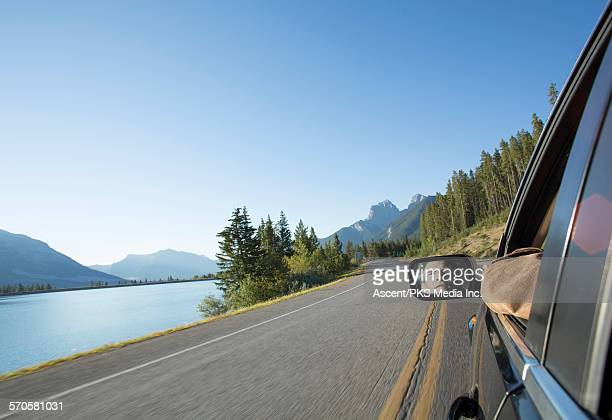 POV of man driving car on mountain highway