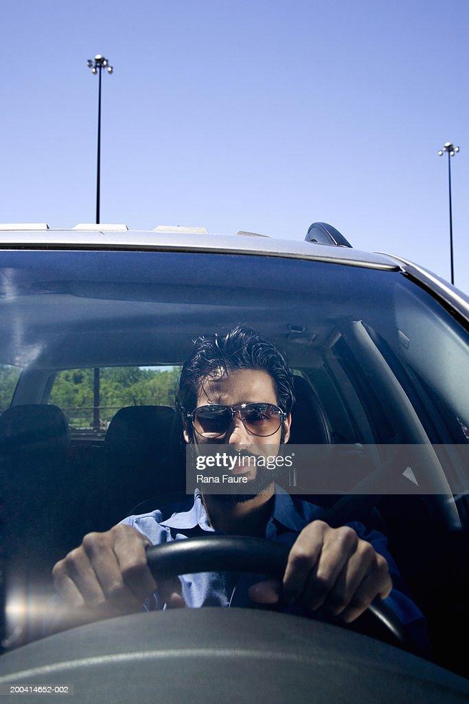 Man driving car : Photo