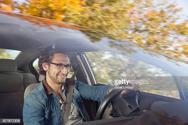 man driving car - driving ストックフォトと画像