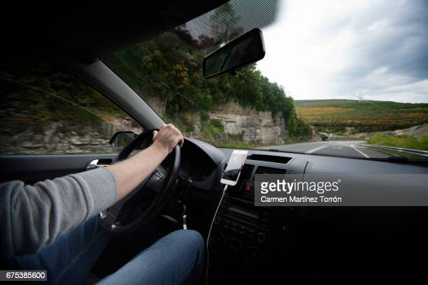 man driving car - stubble stock pictures, royalty-free photos & images