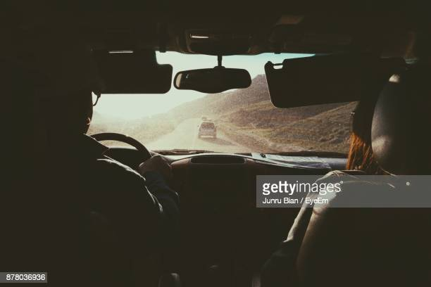man driving car - mongolian women stock photos and pictures