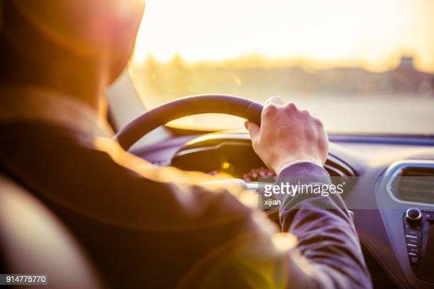 man driving car - driver stock pictures, royalty-free photos & images