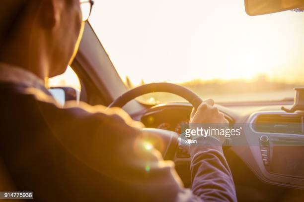 man driving car - car interior stock pictures, royalty-free photos & images