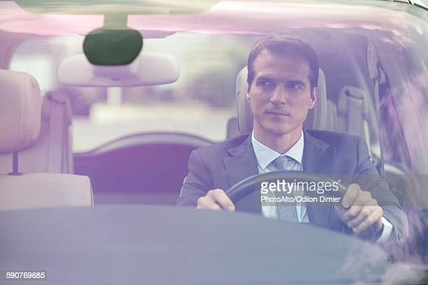 Man driving car without passengers