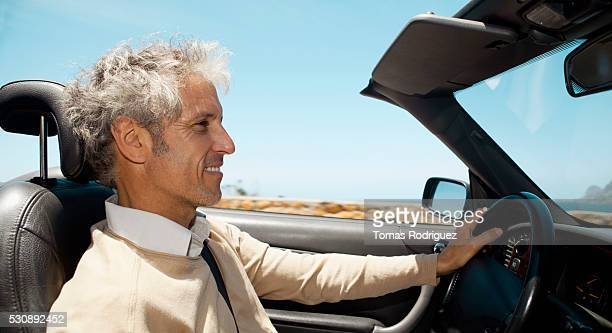 man driving convertible - convertible stock pictures, royalty-free photos & images