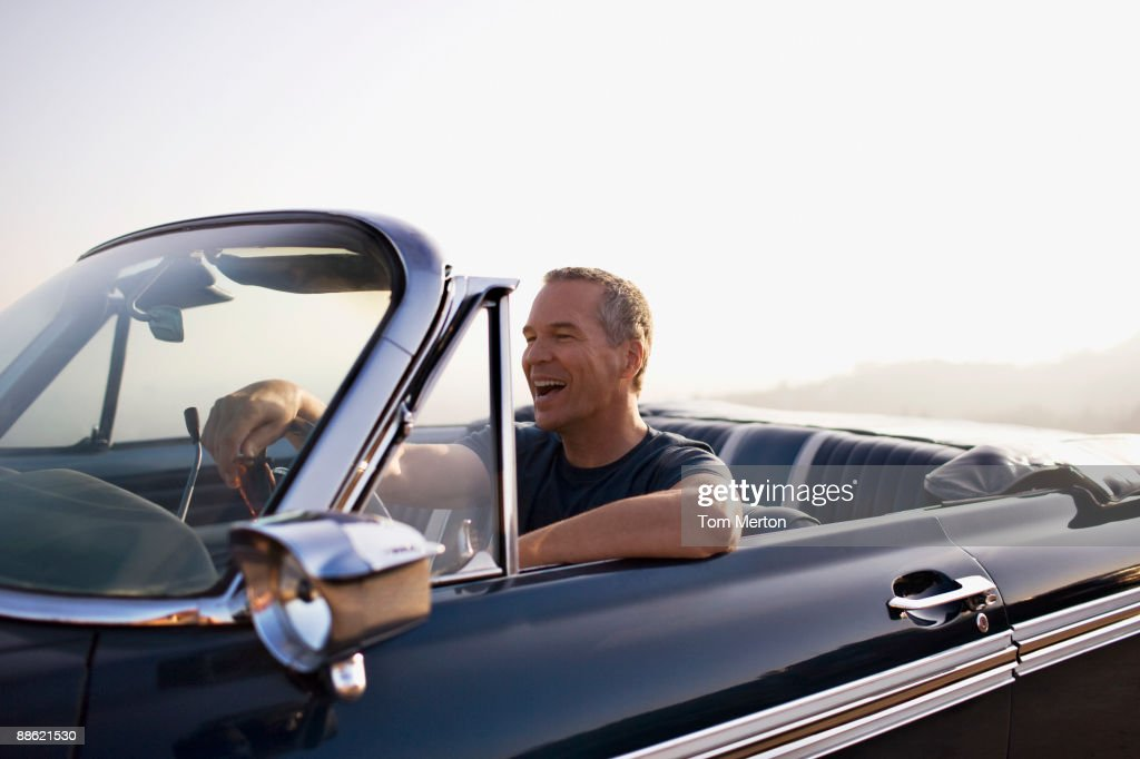 Man driving convertible : Stock Photo