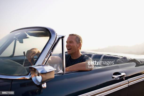 man driving convertible - luxury stock pictures, royalty-free photos & images