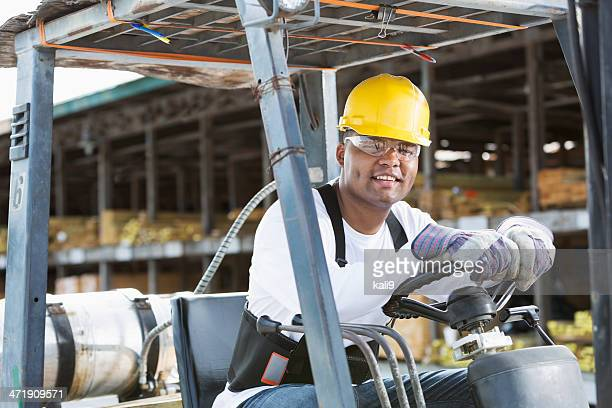 man driving forklift - work glove stock photos and pictures