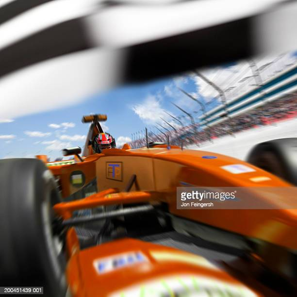 Man driving Formula 1 race car under flag (Digital Composite)