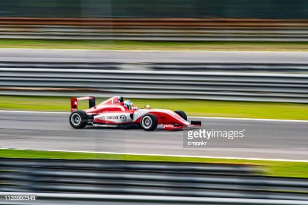 man driving formula racing car - race car stock pictures, royalty-free photos & images