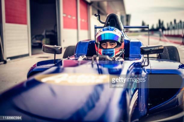 man driving formula racing car - motorsport stock pictures, royalty-free photos & images