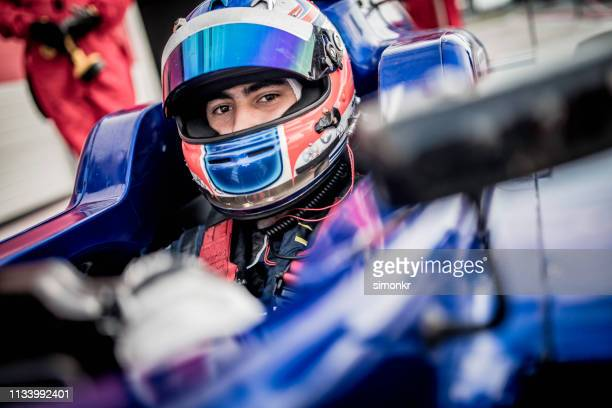 man driving formula racing car - auto racing stock pictures, royalty-free photos & images