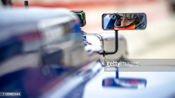 man driving formula racing car - racing driver stock pictures, royalty-free photos & images