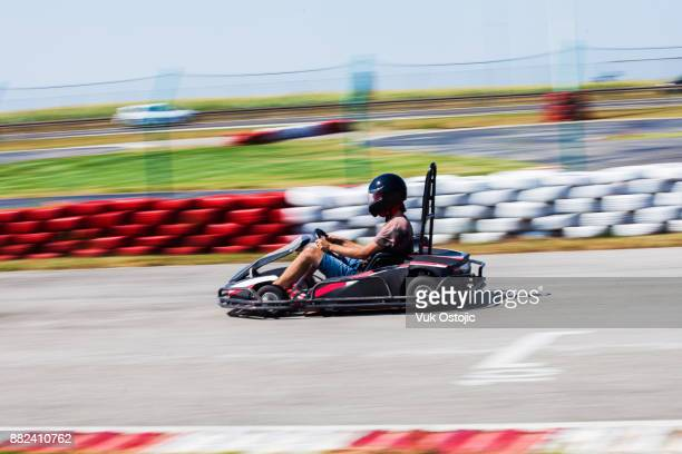 man driving go-cart - go cart stock pictures, royalty-free photos & images