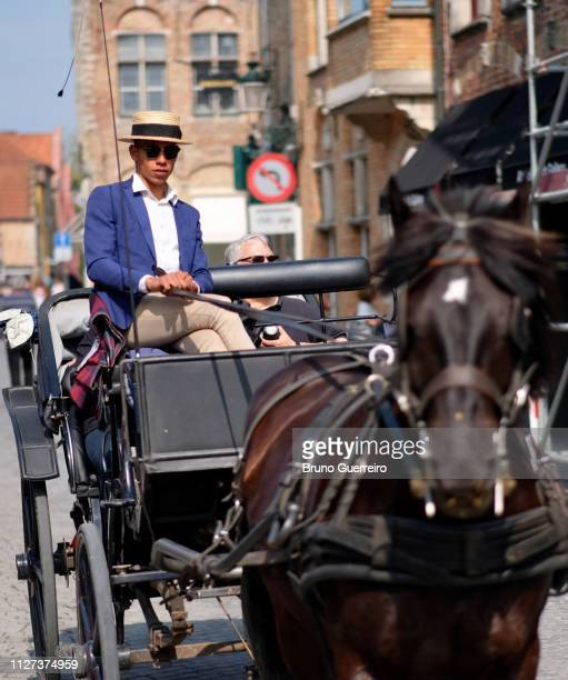 man driving horse carriage in city centre - 西フランダース ストックフォトと画像